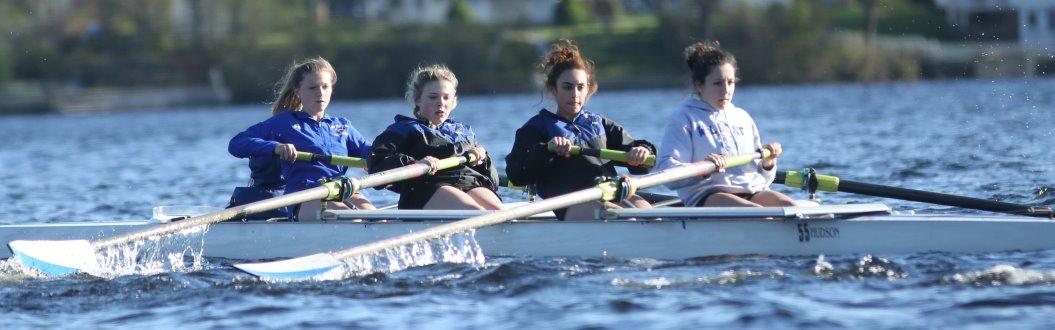 Girls Crew in Boat on Lake